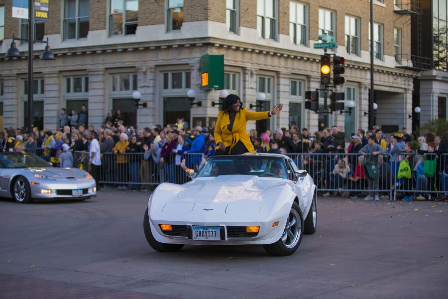 Vice President of Student Life Dr. Melissa Shivers rides in a Corvette during the 2019 Homecoming Parade on Oct. 18 in Downtown Iowa City.(Reba Zatz/The Daily Iowan)