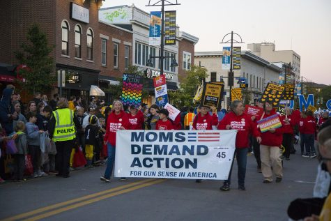 Members of Moms Demand Action march during the 2019 Homecoming Parade on Oct. 18 in Downtown Iowa City.