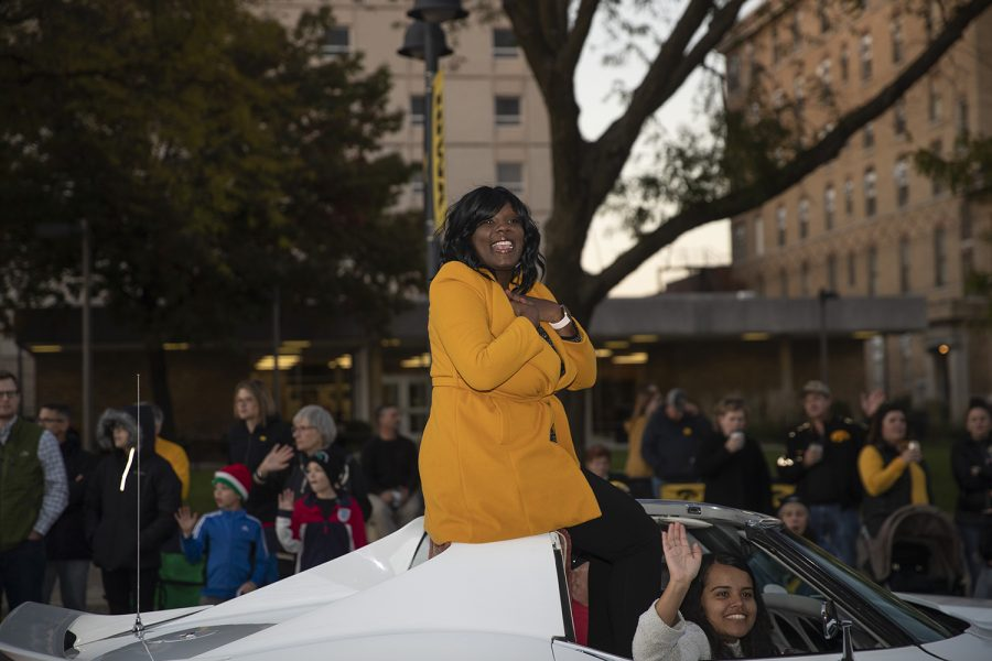 Vice President for Student Life Melissa Shivers reacts to a compliment during the University of Iowa Homecoming Parade through downtown Iowa City on Friday, Oct. 18, 2019.