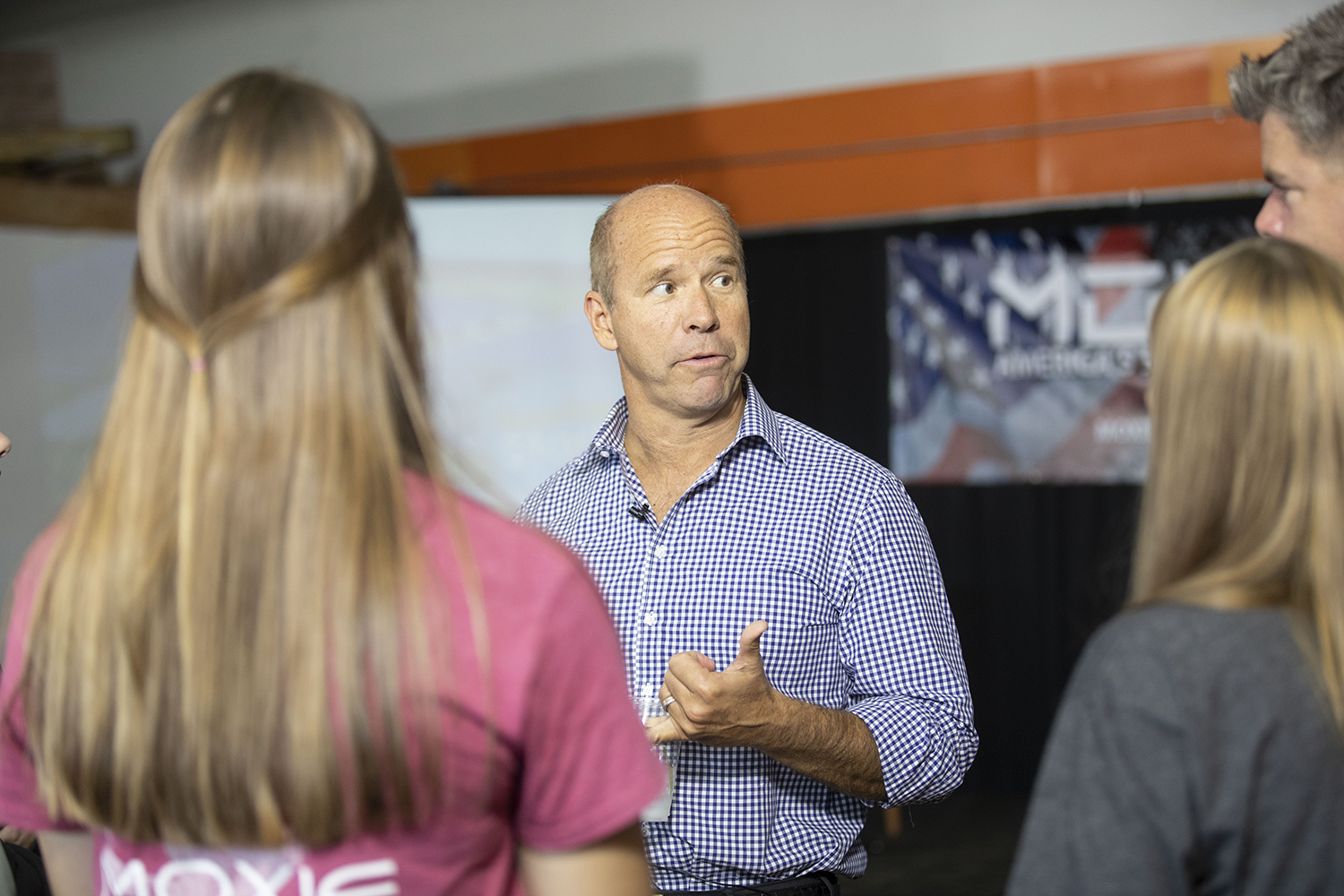 2020 Democratic Candidate and former Maryland Congressman John Delaney speaks to business owner Jason Hall and his family at Moxie Solar in North Liberty, IA, on Friday, Oct. 18, 2019. The visit was part of John Delaney's Heartland Startup Tour.