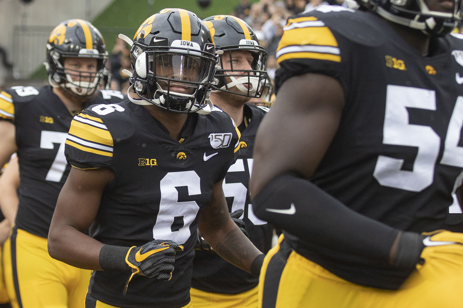 Iowa players run onto the field before the Iowa football game against Purdue at Kinnick Stadium on Saturday, Oct. 19, 2019. The Hawkeyes defeated the Boilermakers 26-20.
