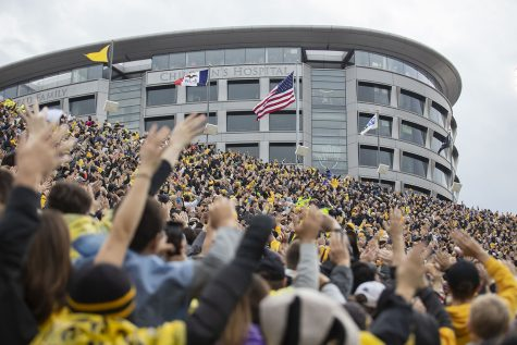 Iowa fans wave to patients in the Stead Family Children's Hospital after the first quarter of the Iowa football game against Purdue at Kinnick Stadium on Saturday, Oct. 19, 2019. The Hawkeyes defeated the Boilermakers 26-20.