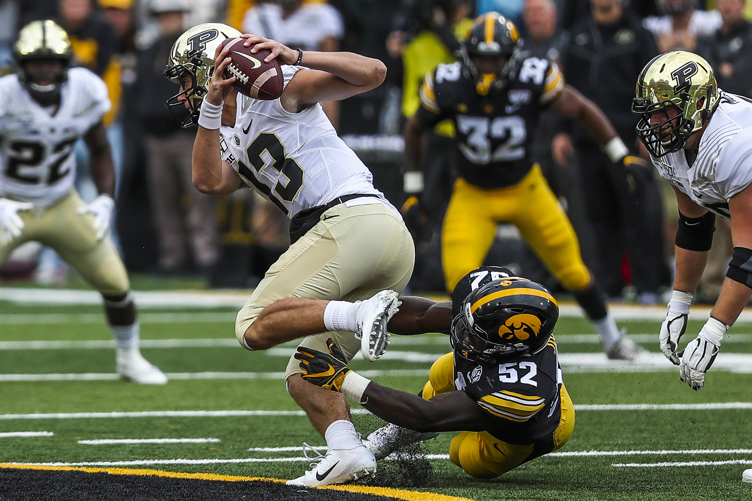 Iowa linebacker Amani Jones attempts to tackle Purdue quarterback Jack Plummer during the Iowa football game against Purdue at Kinnick Stadium on Saturday, Oct. 19, 2019. The Hawkeyes defeated the Boilermakers 26-20.