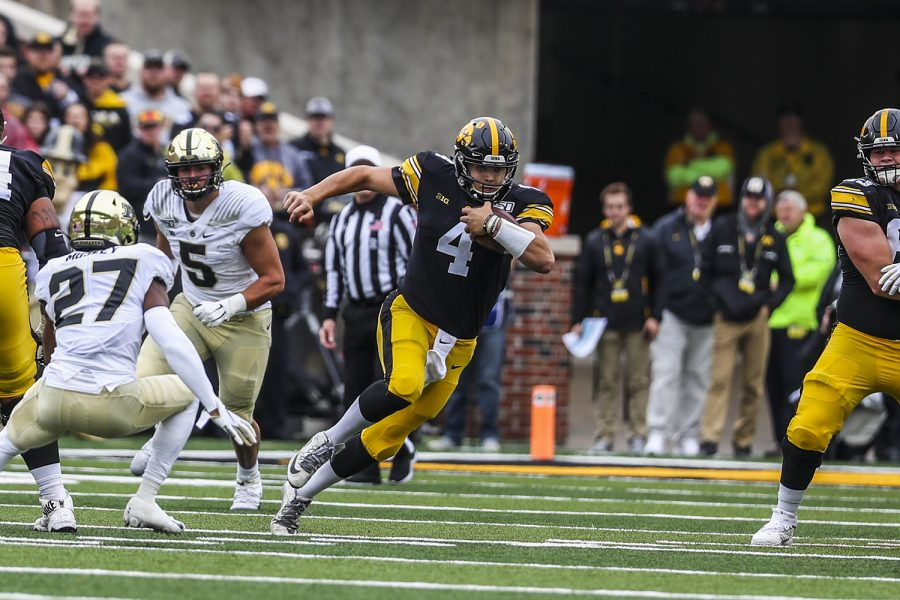Iowa+quarterback+Nate+Stanley+runs+the+ball+during+the+Iowa+football+game+against+Purdue+at+Kinnick+Stadium+on+Saturday%2C+Oct.+19%2C+2019.+The+Hawkeyes+defeated+the+Boilermakers+26-20.