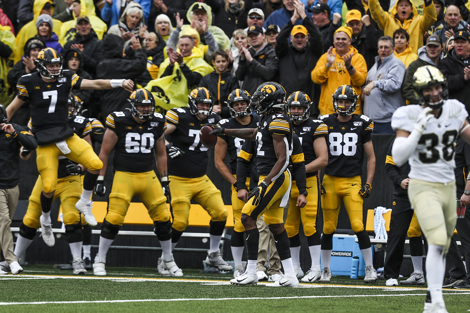 Iowa players react to wide receiver Brandon Smith's catch during the Iowa football game against Purdue at Kinnick Stadium on Saturday, Oct. 19, 2019. The Hawkeyes defeated the Boilermakers 26-20.