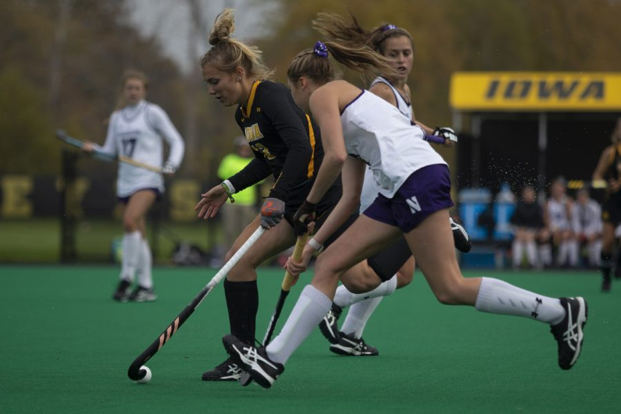 Iowa+forward+Leah+Zellner+keeps+the+ball+away+from+a+Northwestern+player+during+a+field+hockey+game+between+Iowa+and+Northwestern+at+Grant+Field+on+Saturday+Oct.+26%2C+2019.+The+Hawkeyes+defeated+the+Wildcats+2-1.