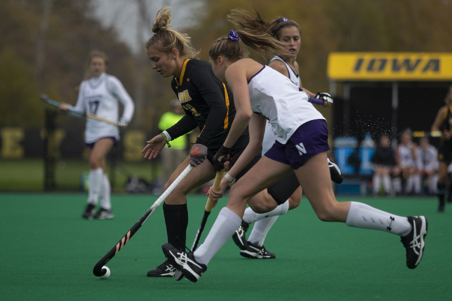 Iowa forward Leah Zellner keeps the ball away from a Northwestern player during a field hockey game between Iowa and Northwestern at Grant Field on Saturday Oct. 26, 2019. The Hawkeyes defeated the Wildcats 2-1.