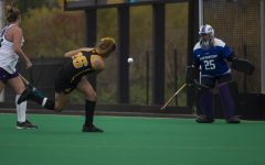 Iowa forward Maddy Murphy shoots toward the goal, scoring the winning point of the field hockey game between Iowa and Northwestern at Grant Field on Saturday Oct. 26, 2019. The Hawkeyes defeated the Wildcats 2-1.