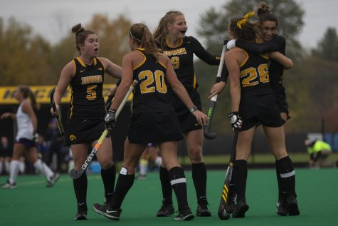 Iowa players celebrate their victory during a field hockey game between Iowa and Northwestern at Grant Field on Saturday Oct. 26, 2019. The Hawkeyes defeated the Wildcats 2-1.