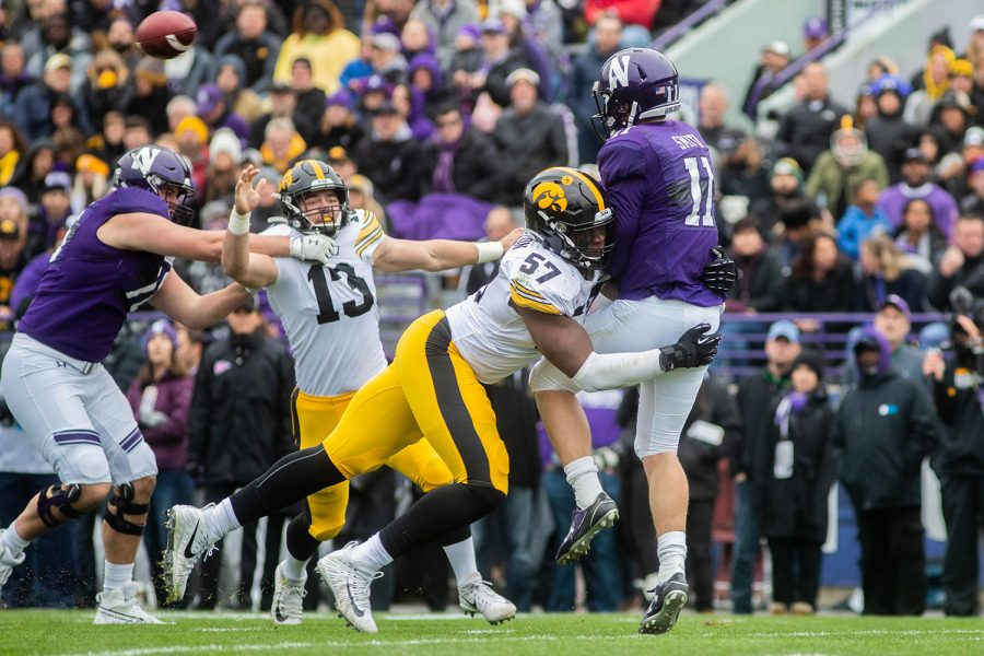 Iowa defensive end Chauncey Golston tackles Northwestern quarter back Aidan Smith during a game against Northwestern at Ryan Field on Saturday, October 26, 2019. The Hawkeyes defeated the Wildcats 20-0. The Hawkeyes had a total of 63 tackles.