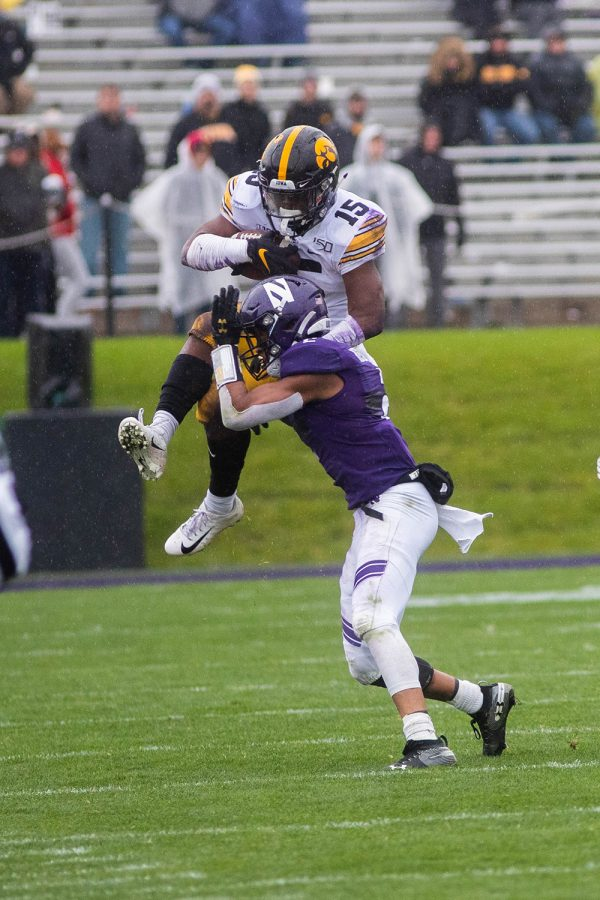 Iowa running back Tyler Goodson jumps over a defender during a game against Northwestern at Ryan Field on Saturday, October 26, 2019. The Hawkeyes defeated the Wildcats 20-0. Goodson rushed for a total of 58 yards.