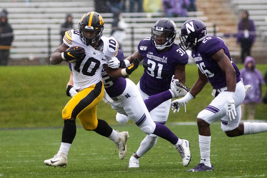 Iowa running back Mekhi Sargent breaks a tackle during a game against Northwestern at Ryan Field on Saturday, October 26, 2019. The Hawkeyes defeated the Wildcats 20-0. Sargent rushed for a total of 46 yards.