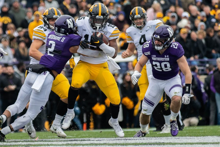 Iowa running back Tyler Goodson breaks a tackle during a game against Northwestern at Ryan Field on Saturday, October 26, 2019. The Hawkeyes defeated the Wildcats 20-0. Goodson rushed for a total of 58  yards.