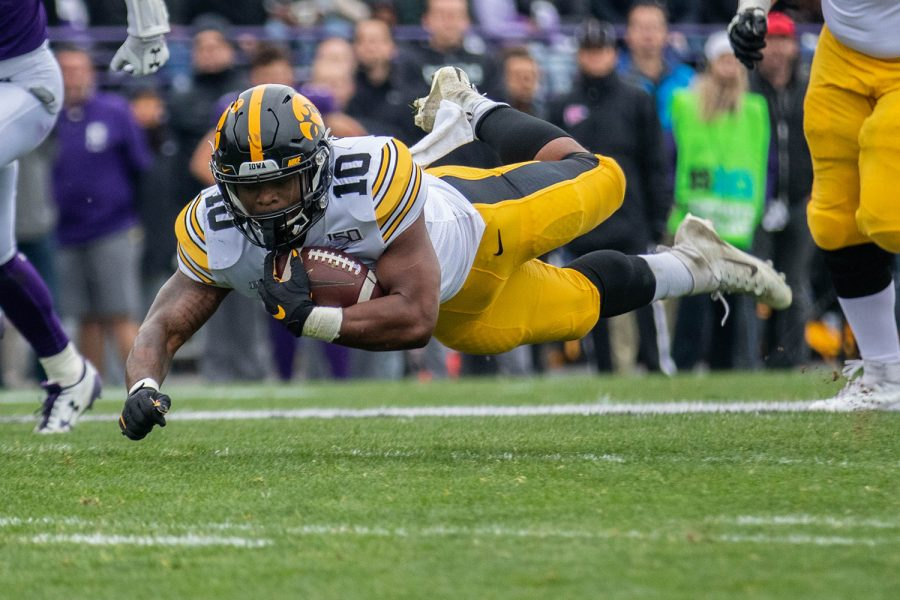 Iowa running back Mekhi Sargent dives during a game against Northwestern at Ryan Field on Saturday, October 26, 2019. The Hawkeyes defeated the Wildcats 20-0. Sargent had 15 carries for a total of 46 yards.
