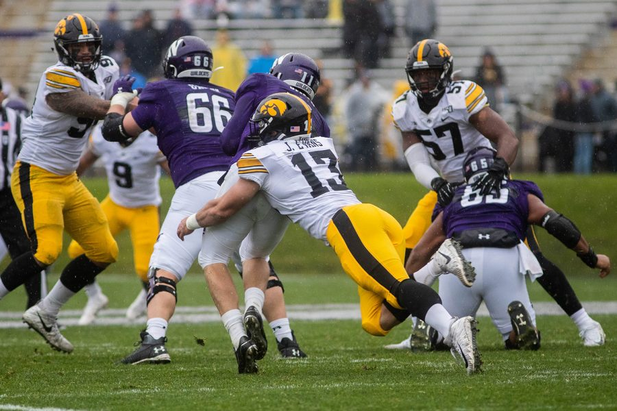 Iowa linebackerJoe Evans sacks Northwestern Quarterback Aidan Smith during a game against Northwestern at Ryan Field on Saturday, October 26, 2019. The Hawkeyes defeated the Wildcats 20-0. Linebacker Joe Evans completed the game with a total of two tackles.