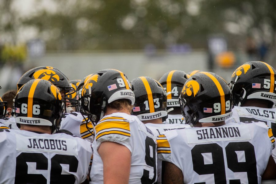 Iowa+players+huddle+up+during+a+game+against+Northwestern+at+Ryan+Field+on+Saturday%2C+October+26%2C+2019.+The+Hawkeyes+defeated+the+Wildcats+20-0.+
