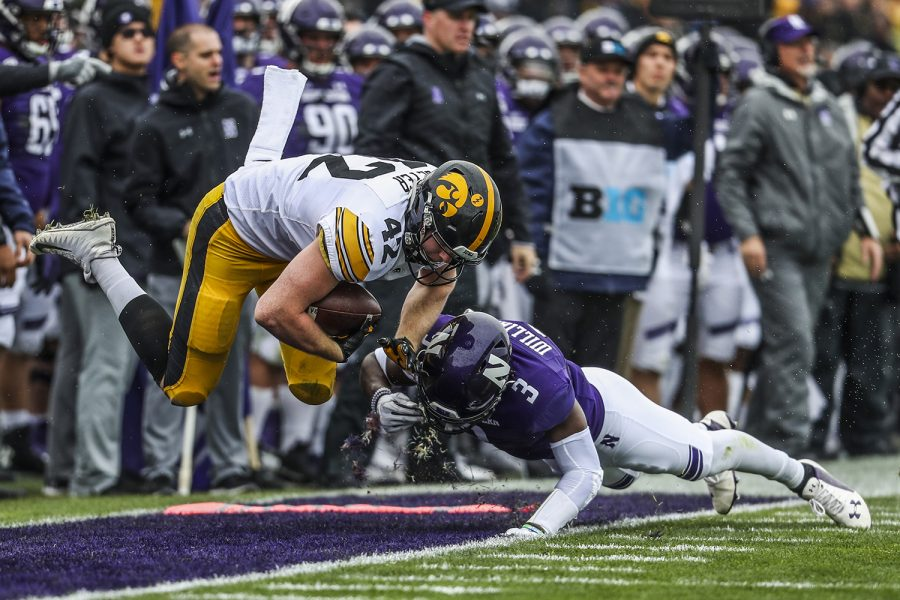 Iowa+tight+end+Shaun+Beyer+flies+over+Northwestern+defensive+back+Trae+Williams+during+the+Iowa+vs.+Northwestern+football+game+at+Ryan+Field+on+Saturday%2C+October+26%2C+2019.+The+Hawkeyes+defeated+the+Wildcats+20-0.+Williams+had+one+tackle+during+the+game.