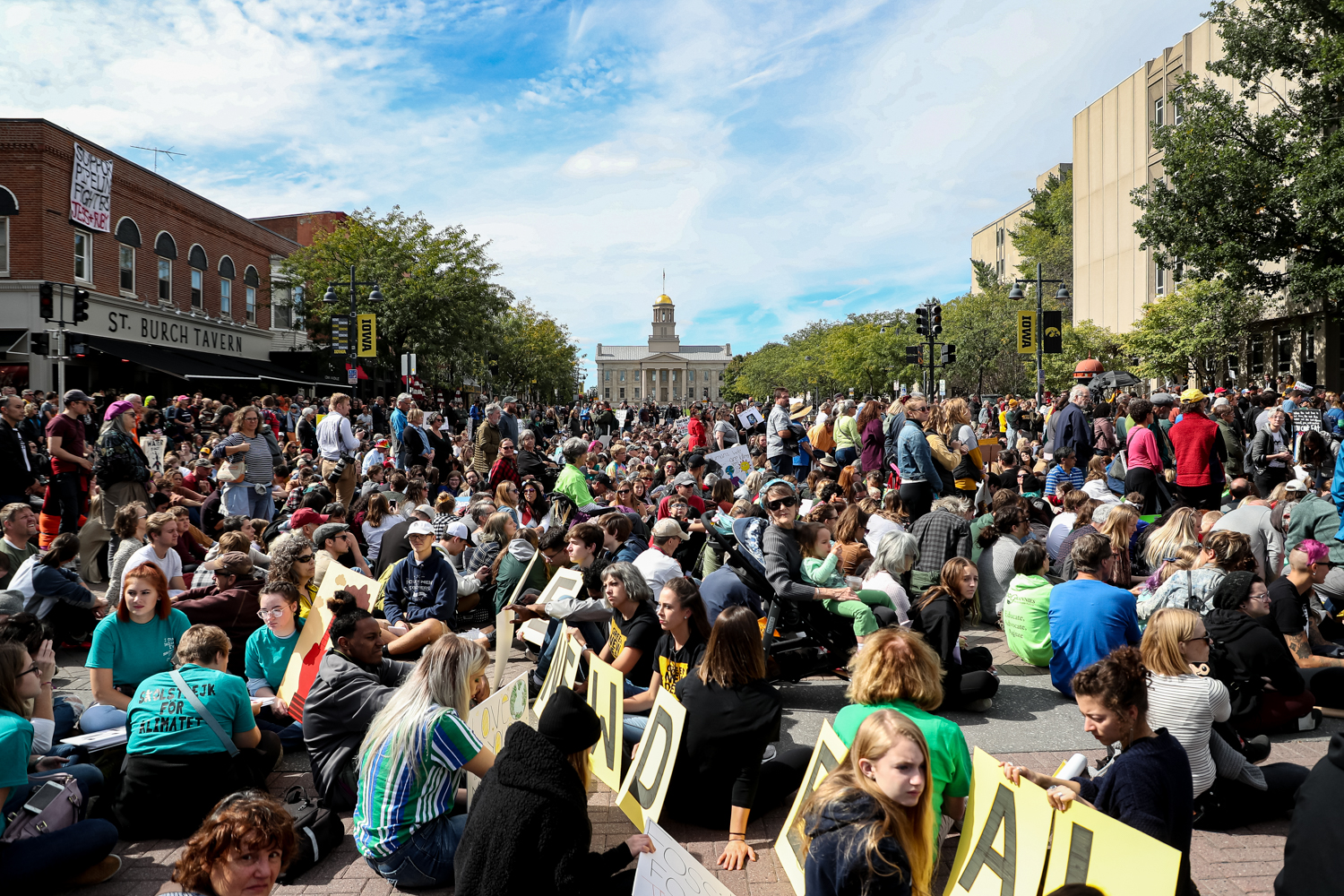 Protesters take part in an 11-minutes sit-down protest during the Iowa City Climate Strike in downtown Iowa City on Friday, Oct. 4, 2019.