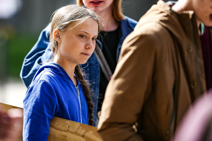 Swedish climate activist Greta Thunberg walks down Iowa Ave. after speaking at the Iowa City Climate Strike in downtown Iowa City on Friday, Oct. 4, 2019. (David Harmantas/For The Daily Iowan)