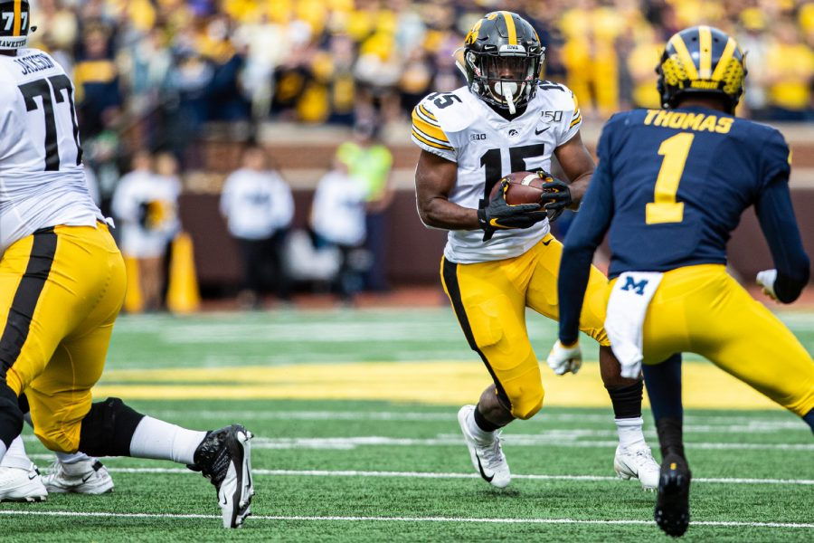 Iowa+running+back+Tyler+Goodson+carries+the+ball+during+a+football+game+between+Iowa+and+Michigan+in+Ann+Arbor+on+Saturday%2C+October+5%2C+2019.+The+Wolverines+celebrated+homecoming+and+defeated+the+Hawkeyes%2C+10-3.+%28Shivansh+Ahuja%2FThe+Daily+Iowan%29