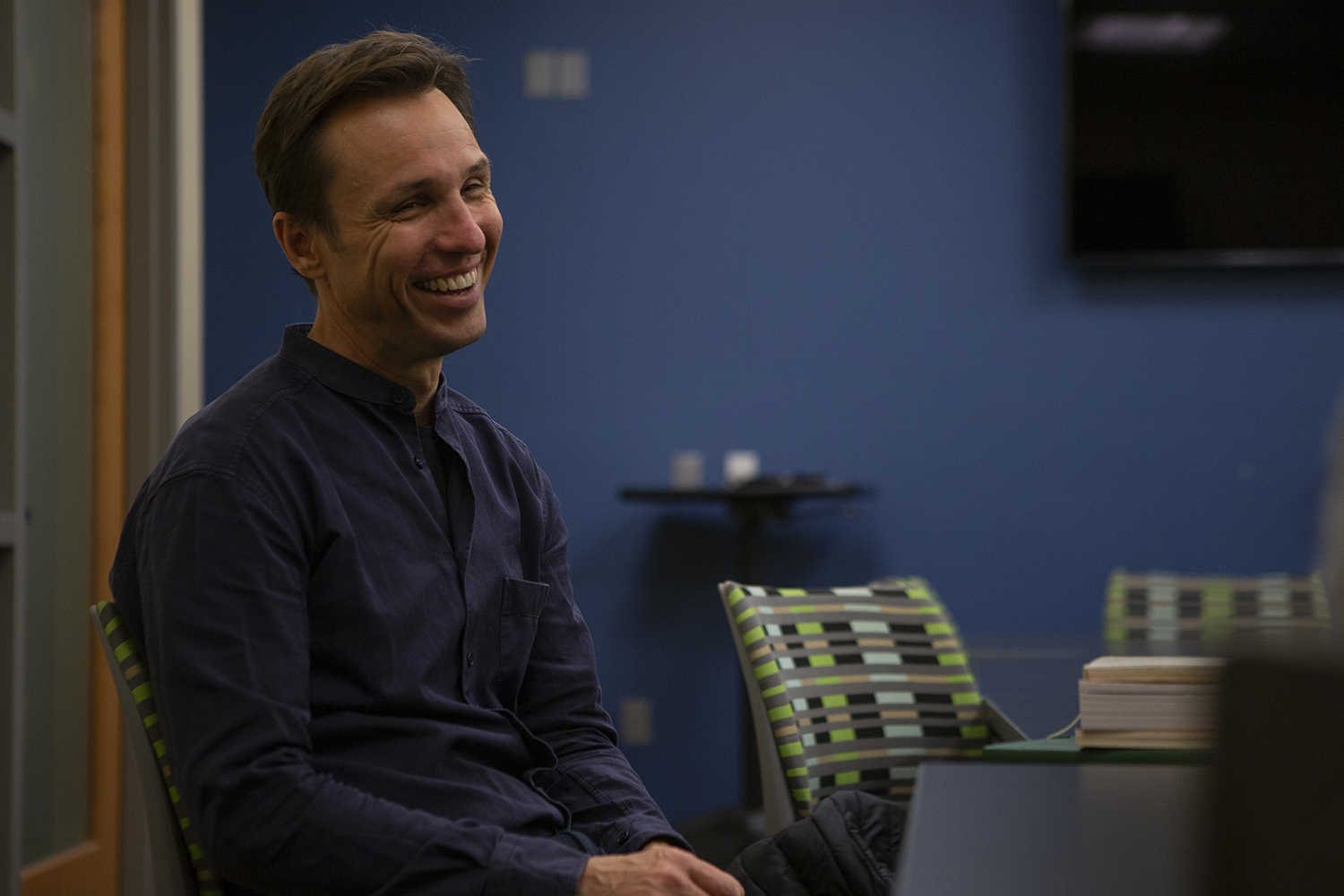 """Author Markus Zusak sits down for an interview with The Daily Iowan in the Iowa City Public Library on Monday, Oct. 21, 2019. Zusak discussed his writing process and his new book """"Bridge of Clay."""" Around 250 people attended his reading."""