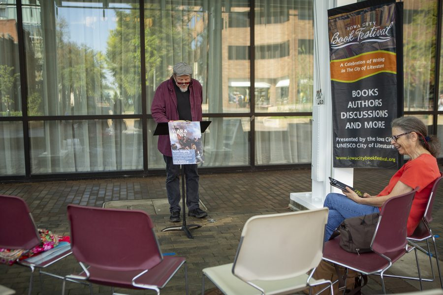 A volunteer reader speaks during a public reading of War and Peace on the Ped Mall on Monday Sept. 30, 2019. As part of the Iowa City Book Festival, readings will continue on the Ped Mall for three days.