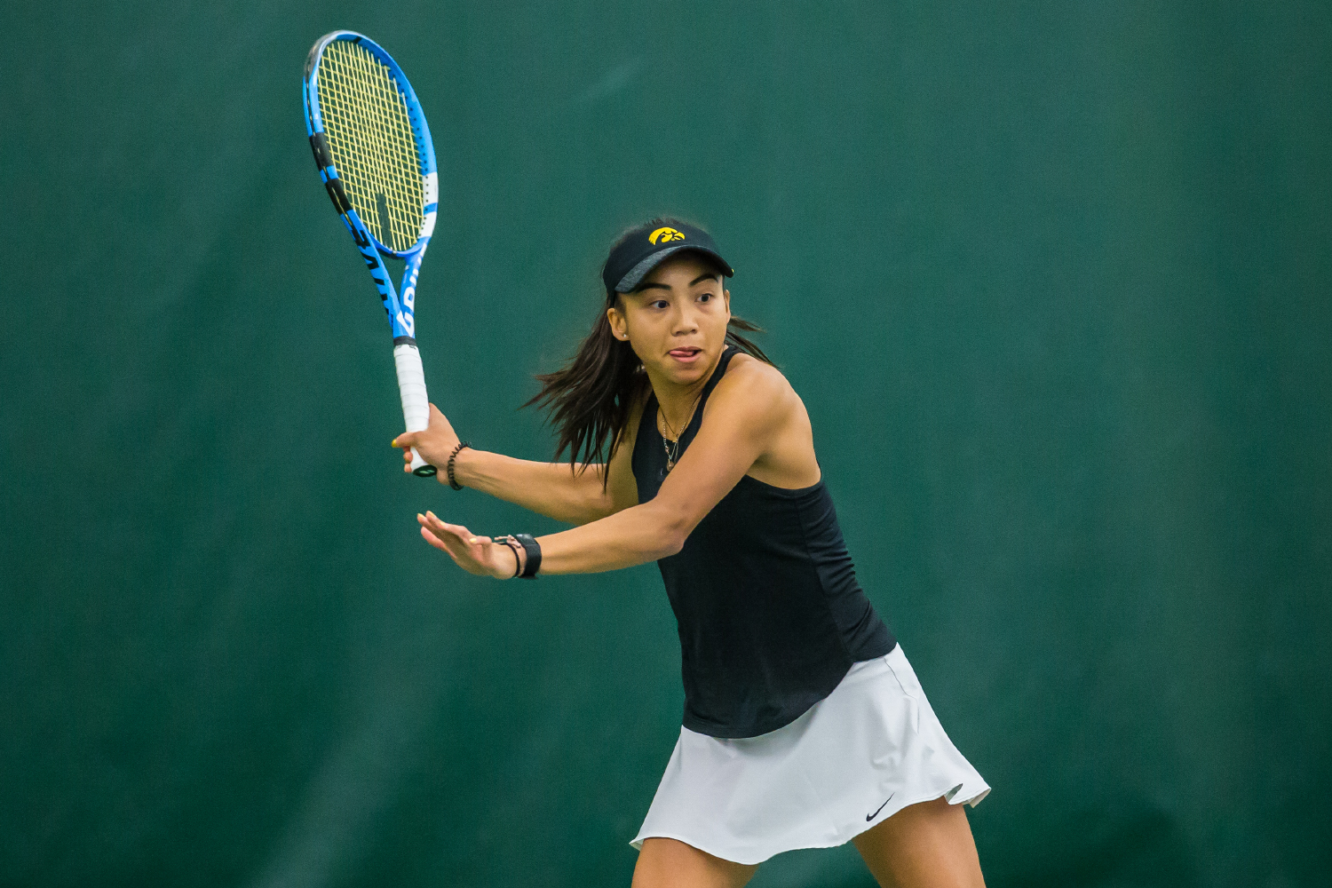 Iowa's Michelle Bacalla hits a forehand during a women's tennis match between Iowa and Nebraska at the HTRC on Saturday, April 13, 2019. The Hawkeyes, celebrating senior day, fell to the Cornhuskers, 4-2.