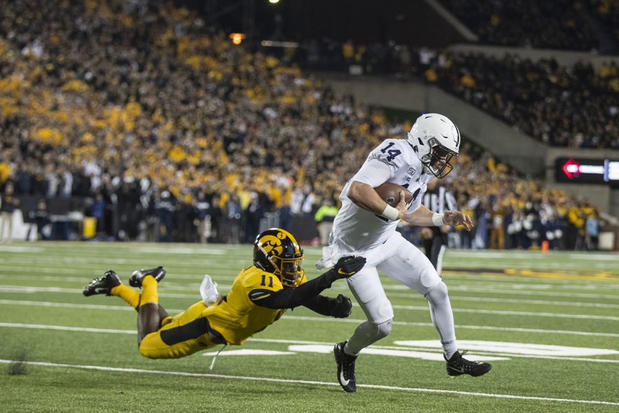 Iowa+DB+Michael+Ojemudia+attempt+to+tackle+Penn+State+QB+Sean+Clifford+during+the+Iowa+football+vs.+Penn+State+game+in+Kinnick+Stadium+on+Saturday%2C+Oct.+12%2C+2019.+The+Nittany+Lions+defeated+the+Hawkeyes+17-12.+%28Katie+Goodale%2FThe+Daily+Iowan%29