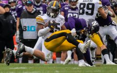 Iowa running back Tyler Goodson completes a carry during a game against Northwestern at Ryan Field on Saturday, October 26, 2019. The Hawkeyes defeated the Wildcats 20-0.
