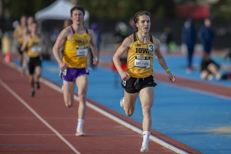 Iowa distance runner Nathan Mylenek leads the pack of the 1500-meter run at the Musco Twilight Invitational at the Cretzmeyer Track on Saturday, April 13, 2019. Mylenek won the race with a time 3:52:06. The Hawkeyes won 10 events during the meet. The Iowa women ranked first with 183 points, and the men ranked fifth 76 points.