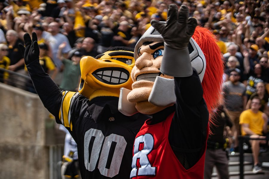 Mascots+participate+in+the+Hawkeye+Wave+during+a+football+game+between+Iowa+and+Rutgers+at+Kinnick+Stadium+on+Saturday%2C+September+7%2C+2019.+The+Hawkeyes+defeated+the+Scarlet+Knights%2C+30-0.+%28Shivansh+Ahuja%2FThe+Daily+Iowan%29