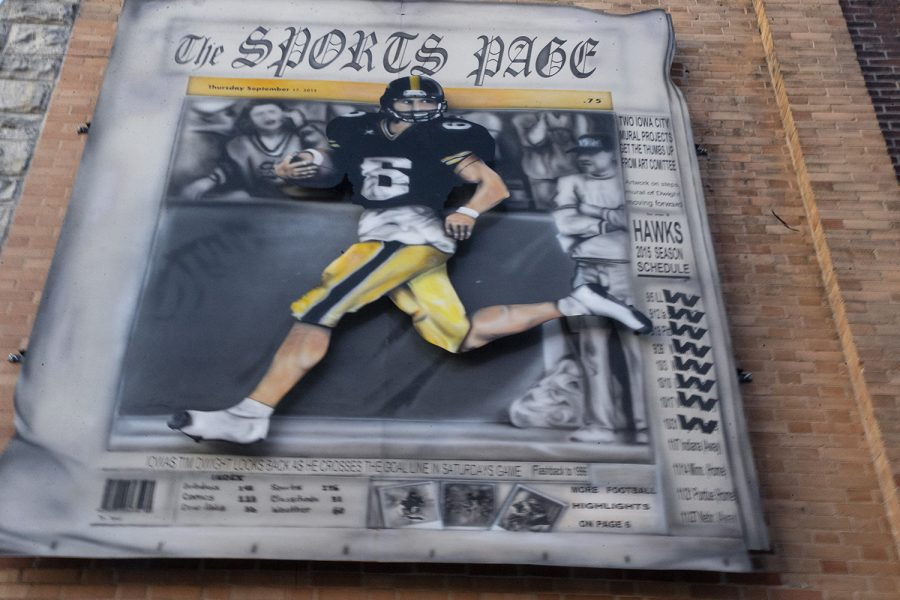 The Sports Page art piece in the alley beside US Bank in Downtown Iowa City on October 7, 2019.  (Raquele Decker/The Daily Iowan)
