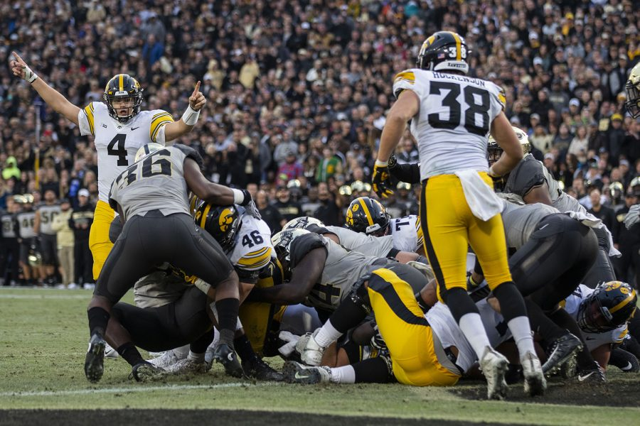 Iowa quarterback Nate Stanley (4) gestures at a possible Iowa touchdown from Iowa fullback Austin Kelly (46) during the Iowa/Purdue game at Ross-Ade Stadium in West Lafayette, Ind. The Boilermakers defeated the Hawkeyes, 38-36, with a last second field goal. (Lily Smith/The Daily Iowan)