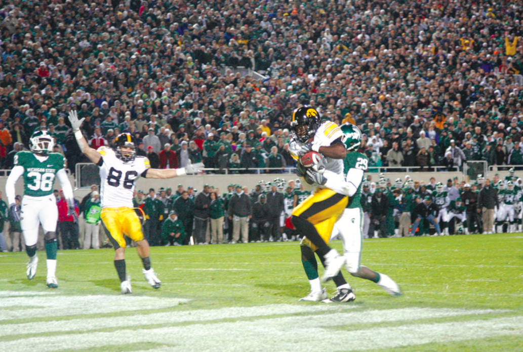 With two seconds left on the clock going into the play, Iowa wide receiver Marvin McNutt catches a 7-yard touchdown pass from Iowa quarterback Ricky Stanzi to win the game against Michigan State on Oct. 24 in East Lansing. The 15-13 victory gave the Hawkeyes an 8-0 record for the first time in school history.