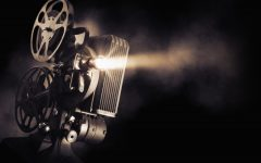 Movie projector on a dark background with light beam / high contrast image