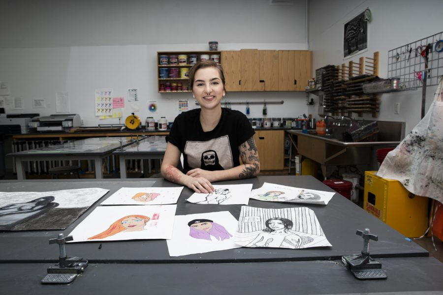 The artwork of university of Iowa student, Adrianna Elgatian poses is seen in the Visual Arts Building in Iowa City on Monday, October 28, 2019. Adrianna is a painter/printmaker who works under the pseudonym, Blacksheep. (Tate Hildyard/The Daily Iowan.)