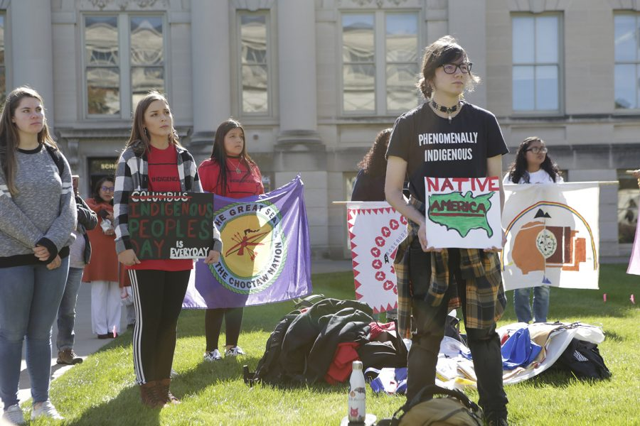 Rally+attendees+hold+signs+during+the+decolonization+rally+on+the+Pentacrest+on+Monday%2C+Oct.+15%2C+2019.+The+rally+featured+speakers+and+music.+