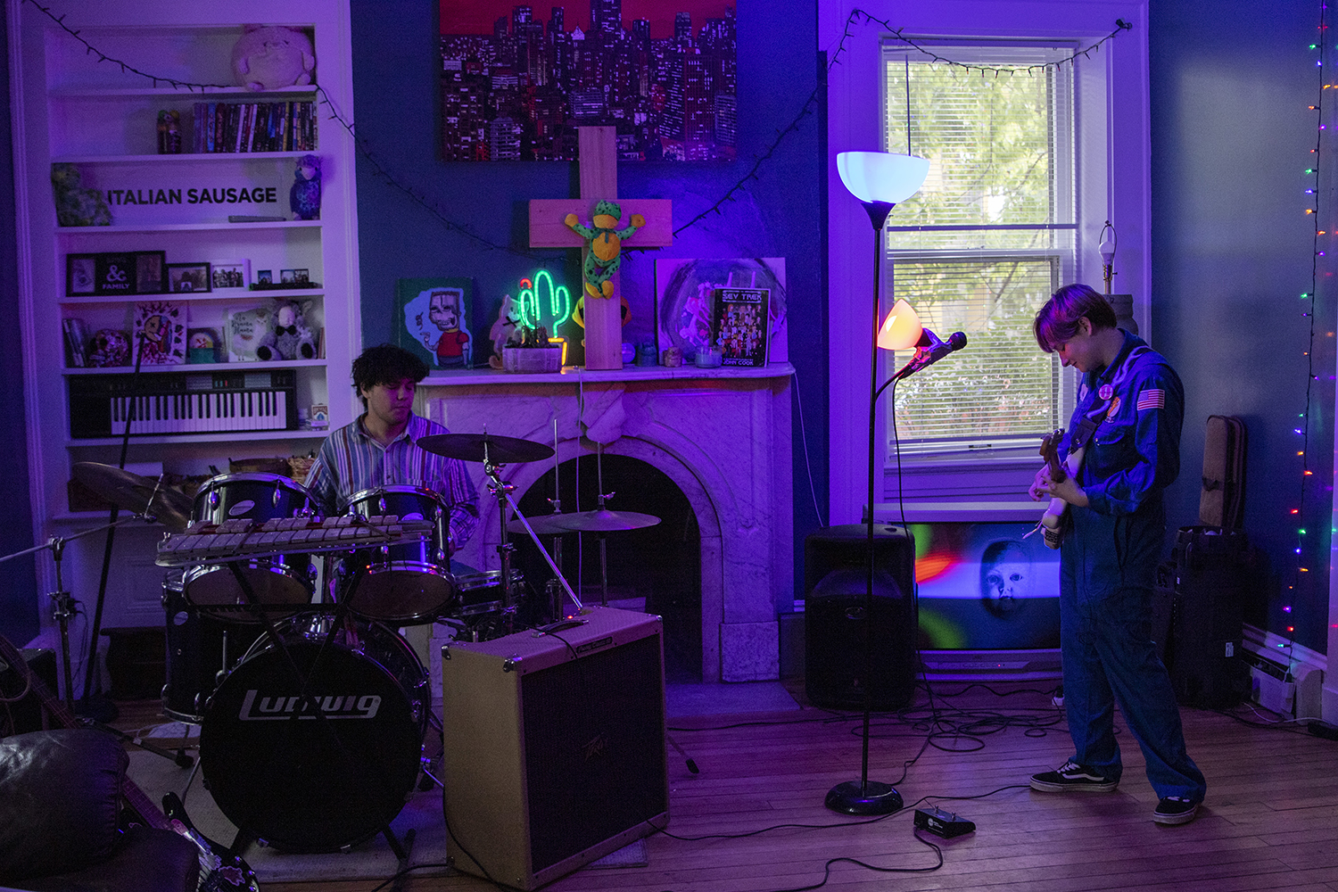 Adelina Reels practices with bandmate John Quijas in their home on Sunday, Oct. 13, 2019. Reels and Quijas are in the band Dog Dave and recently won The of Battle of the Bands at the University of Iowa.