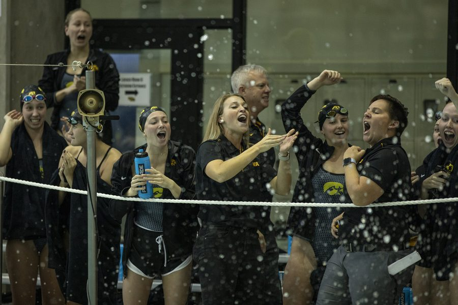 University+of+Iowa+swimmers+cheer+as+their+teammates+compete+in+the+Men%E2%80%99s+200+Freestyle+during+a+swim+meet+between+Iowa+and+Minnesota+at+the+CRWC+on+Oct.+26.+Iowa%E2%80%99s+Aleksey+Tarasenko+won+the+event+with+a+time+of+44.21.