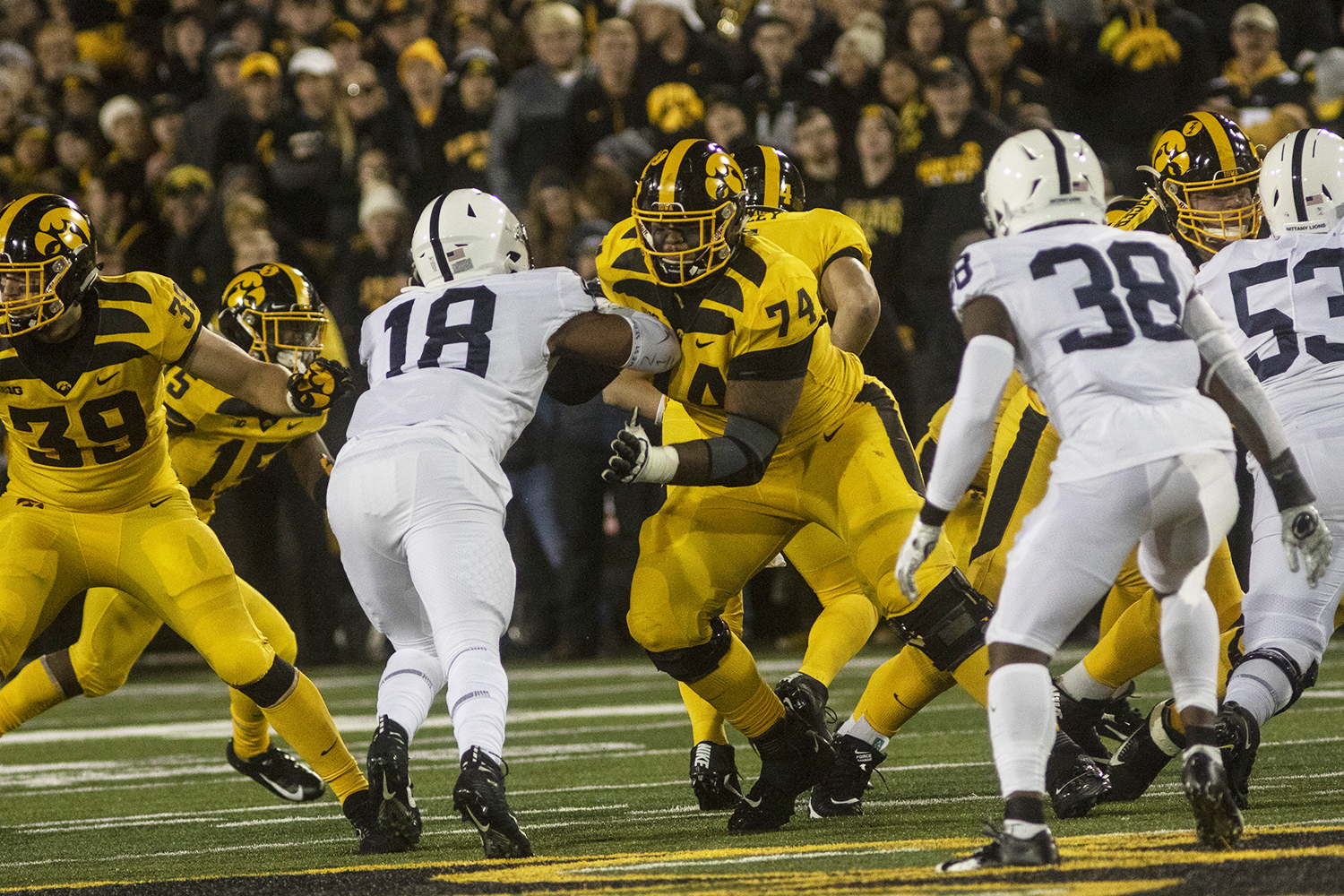 Iowa OL Tristan Wirfs defends QB Nate Stanley during the Iowa football vs. Penn State game in Kinnick Stadium on Saturday, Oct. 12, 2019. The Nittany Lions defeated the Hawkeyes 17-12.
