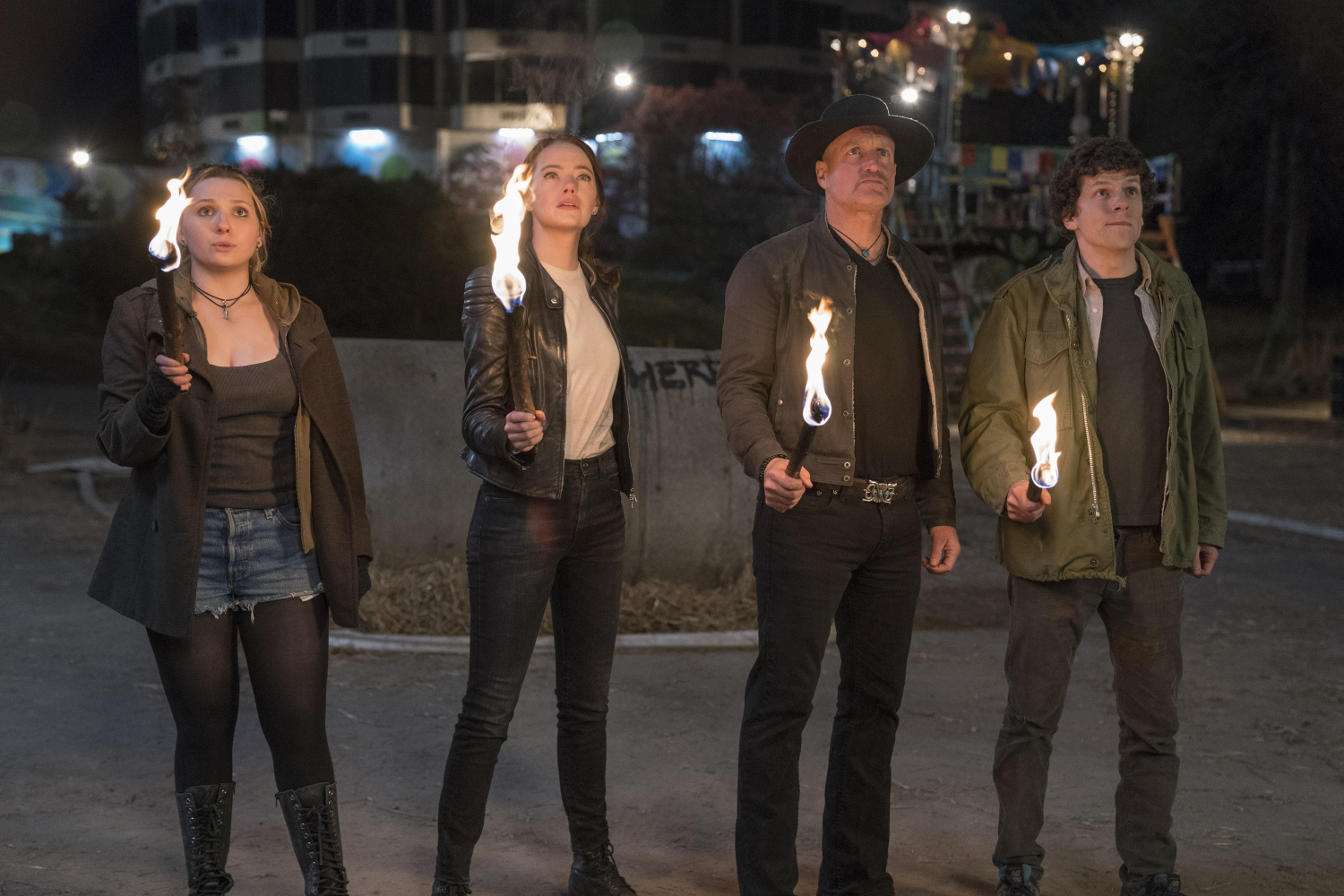 "Little Rock (Abigail Breslin), Wichita (Emma Stone), Tallahassee (Woody Harrelson) and Columbus (Jesse Eisenberg) appear in a scene from ""Zombieland: Double Tap."""