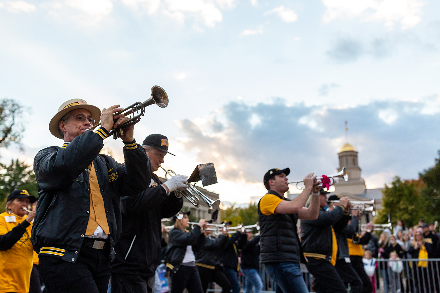 Members of the Hawkeyes Alumni Marching Band march in the Homecoming Parade on Friday, Oct. 19, 2018.