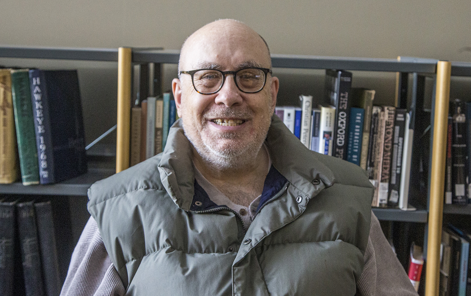 In Adler Journalism Building on Tuesday, Oct. 15, 2019 poet Steven Anderson Author of Journal to Narayama and Love Poems poses for a photo. Steven currently is living in Iowa City where he enjoys writing from his home.