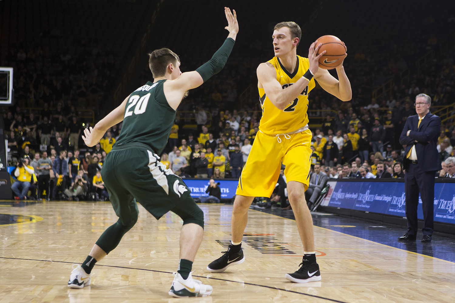 Iowa F Jack Nunge faces off with Michigan State G Matt McQuaid (20) during a basketball game between Iowa and Michigan State at Carver-Hawkeye Arena on Tuesday, Feb. 6, 2018. The Hawkeyes were defeated by the visiting Spartans, 96-93.