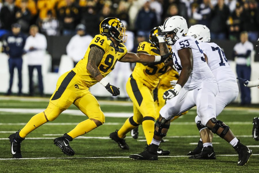 Iowa+defensive+end+A.J.+Epenesa+defends+against+Penn+State+offensive+lineman+Rasheed+Walker+during+the+Iowa+football+game+against+Penn+State+in+Iowa+City+on+Saturday%2C+Oct.+12%2C+2019.+The+Nittany+Lions+defeated+the+Hawkeyes+17-12.+%28Katina+Zentz%2FThe+Daily+Iowan%29