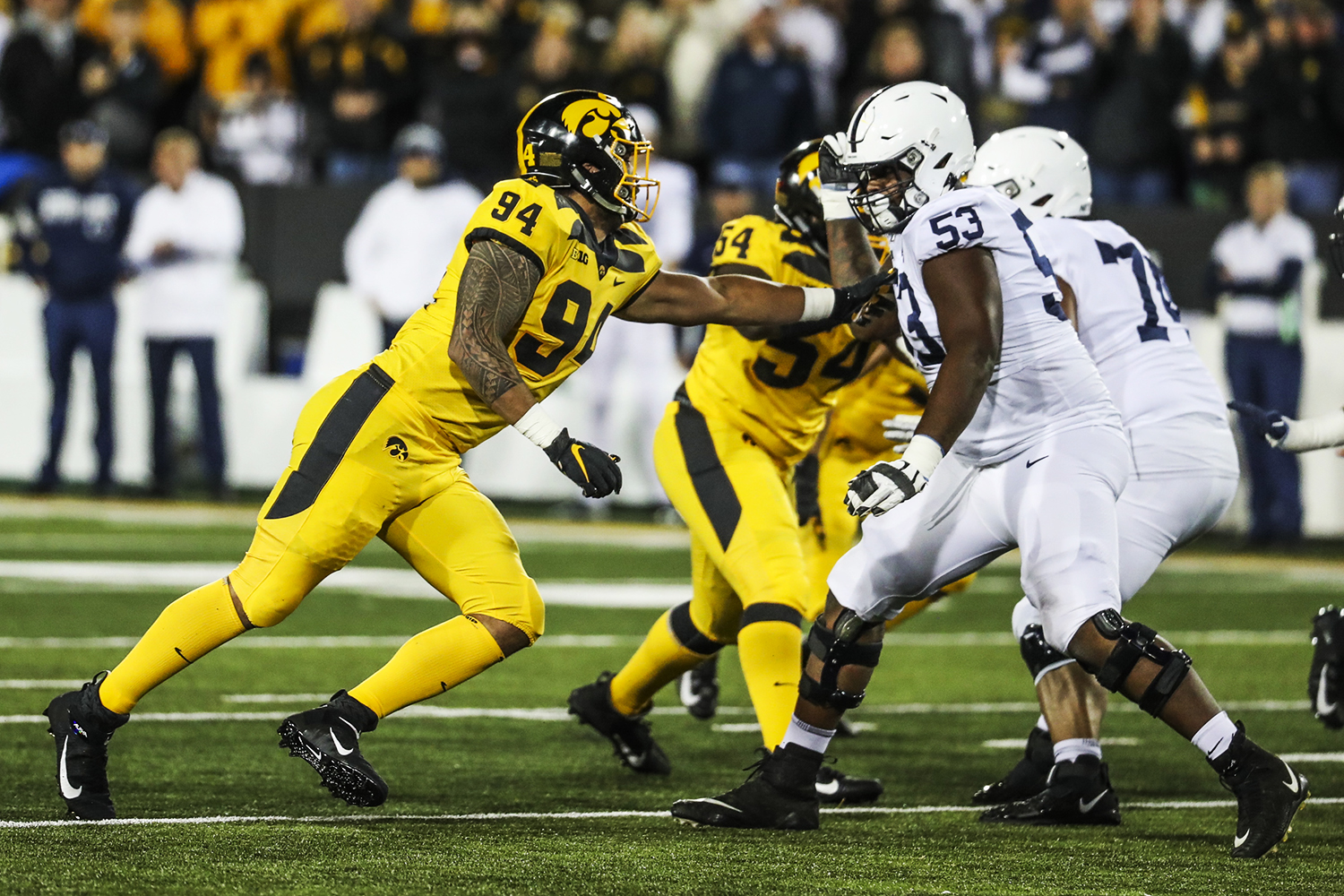 Iowa defensive end A.J. Epenesa defends against Penn State offensive lineman Rasheed Walker during the Iowa football game against Penn State in Iowa City on Saturday, Oct. 12, 2019. The Nittany Lions defeated the Hawkeyes 17-12. (Katina Zentz/The Daily Iowan)
