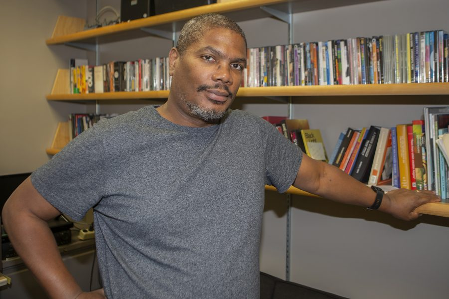Associate Professor Christopher Harris poses for a photo in his office in the Alder Journalism Building on Tuesday, October 22nd, 2019. Harris is the head of film & video production of the University of Iowa department of cinematic arts and his documentary *still/here* was shown at the 2019 Locarno film festival in Switzerland.