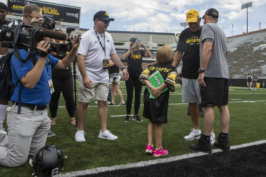 Kid+Captain+Gabby+Yoder+holds+a+large+pack+of+gum+to+give+Hawkeye+Head+Coach+Kirk+Ferentz+at+Kids+Day+at+Kinnick+on+Saturday%2C+August+10%2C+2019.+Kids+Day+at+Kinnick+is+an+annual+event+for+families+to+experience+Iowa%27s+football+stadium%2C+while+watching+preseason+practice+and+honoring+this+year%27s+Kid+Captains.+
