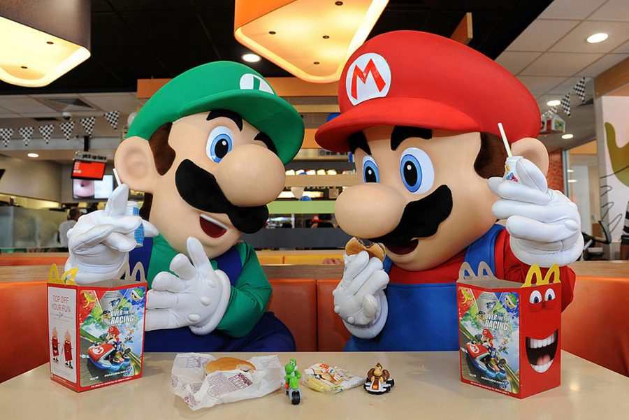 In this photo provided by Nintendo of America, Mario and Luigi enjoy Happy Meals on July 12, 2014 in Los Angeles, California. Nintendo is celebrating the recently released Mario Kart 8 game for the Wii U console by partnering with McDonald's nationwide to include themed toys in Happy Meals. (Bob Riha, Jr./Nintendo of America via Getty Images/TNS)