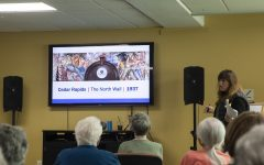 Stanley Museum of Art Senior Living Communities Program Coordinator Amanda Lensing discusses Francis R. White's Cedar Rapids Murals with senior citizens at Melrose Meadows Retirement Community on Thursday, October 24th, 2019. Lensing's presentation focused on murals built in the US midwest after the New Deal in the 1930s.